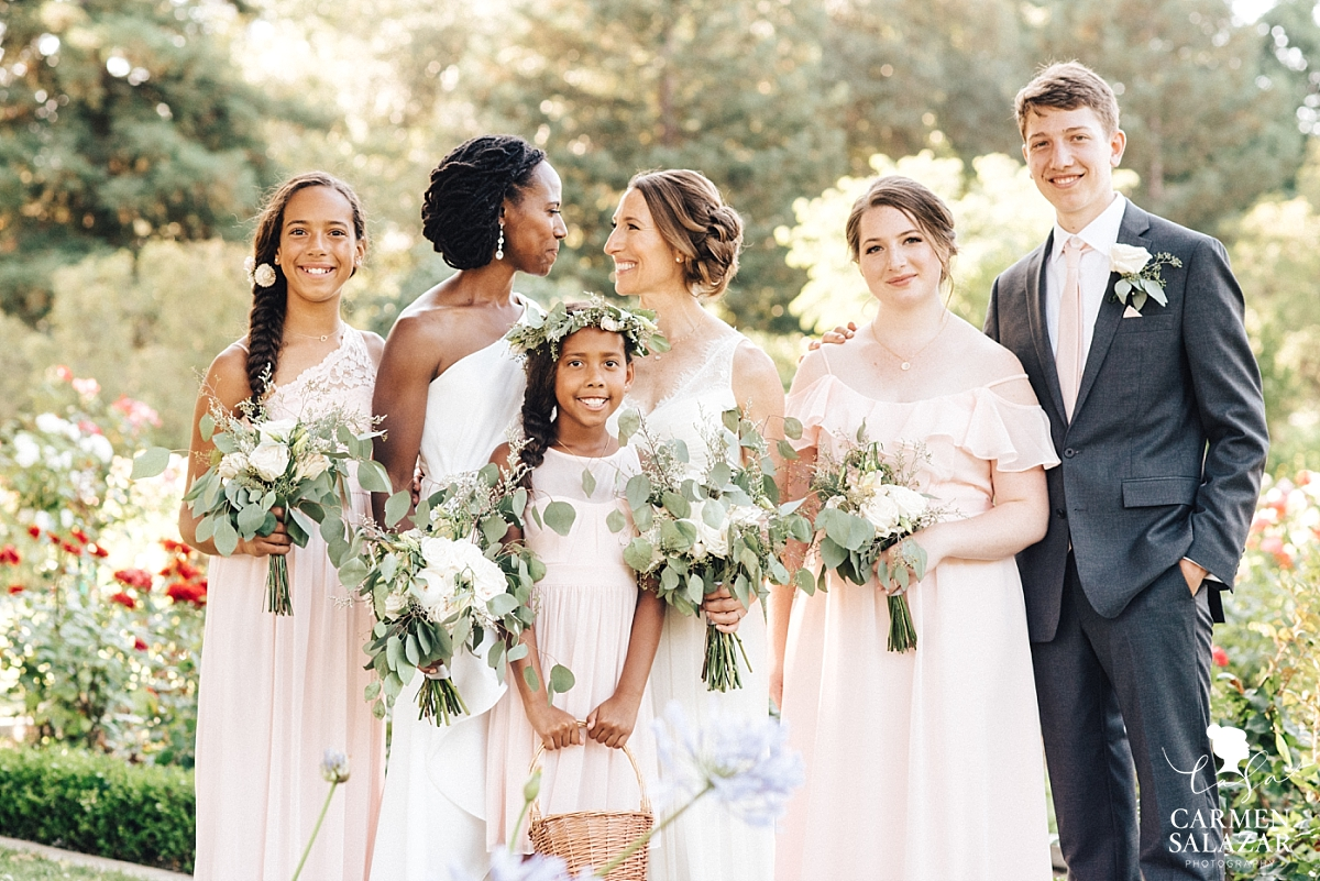 Happy family with the brides in McKinley Rose Garden - Carmen Salazar