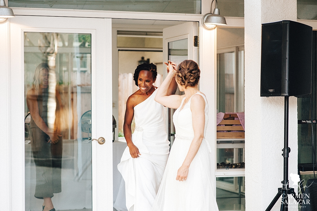 Two brides grand entrance into reception - Carmen Salazar