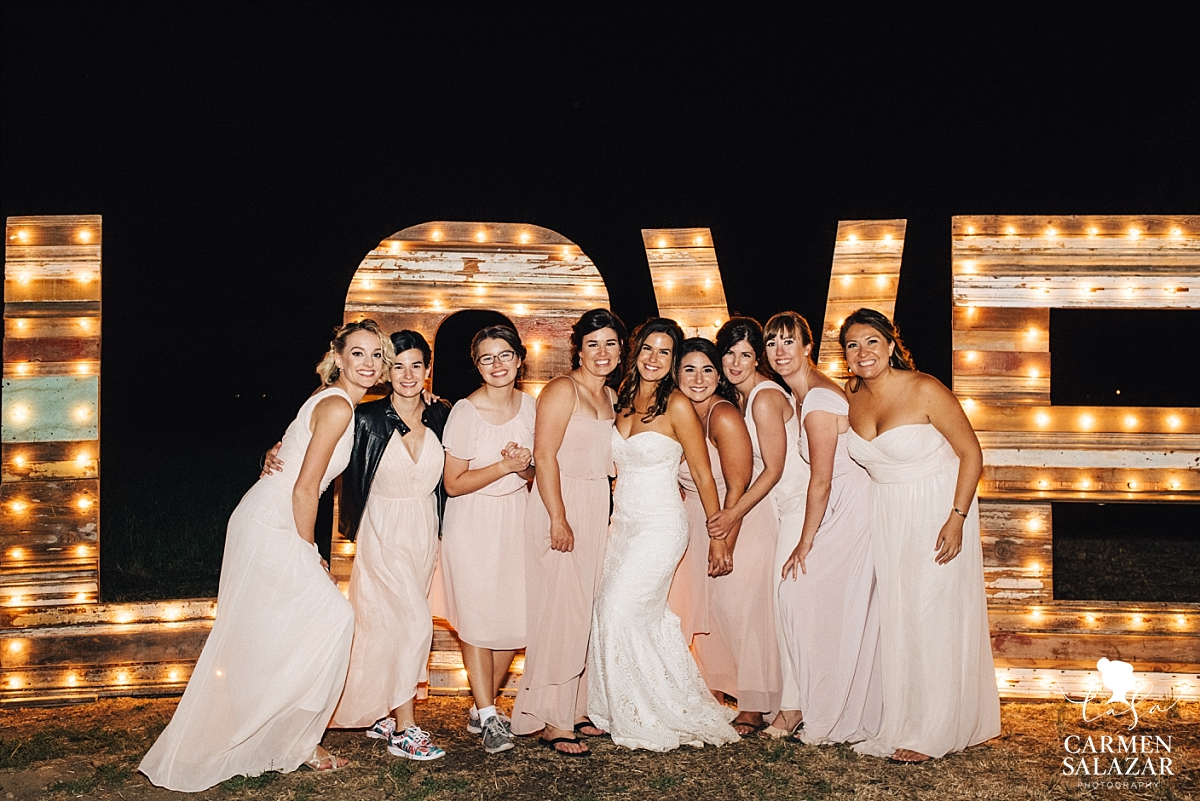 Bridesmaids with custom wood love sign - Carmen Salazar