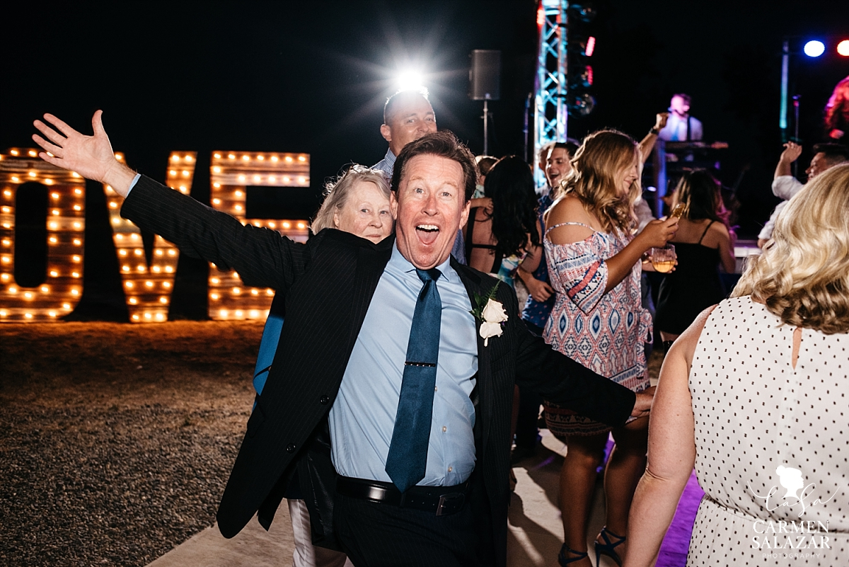 Happy dad on the wedding dance floor - Carmen Salazar