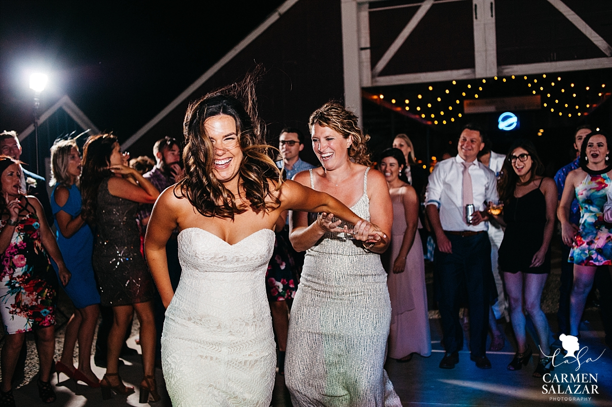 Bride and bridesmaid tearing up the dance floor - Carmen Salazar