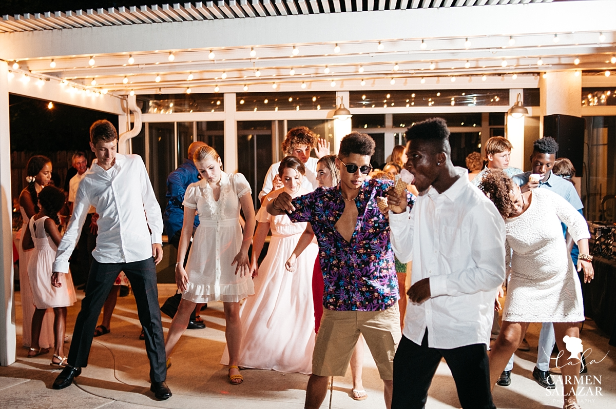 Teenagers tear up the dance floor at reception - Carmen Salazar