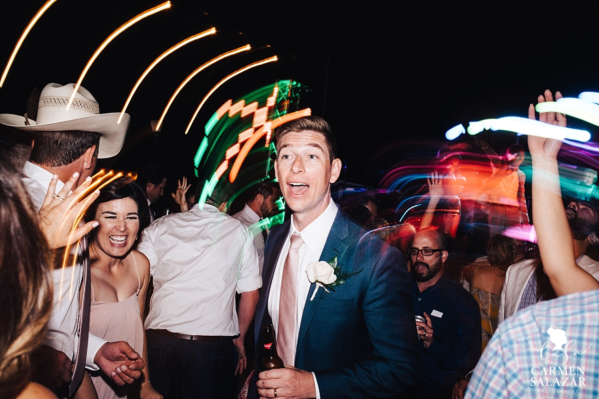 Fun and vibrant groom dancing photos - Carmen Salazar