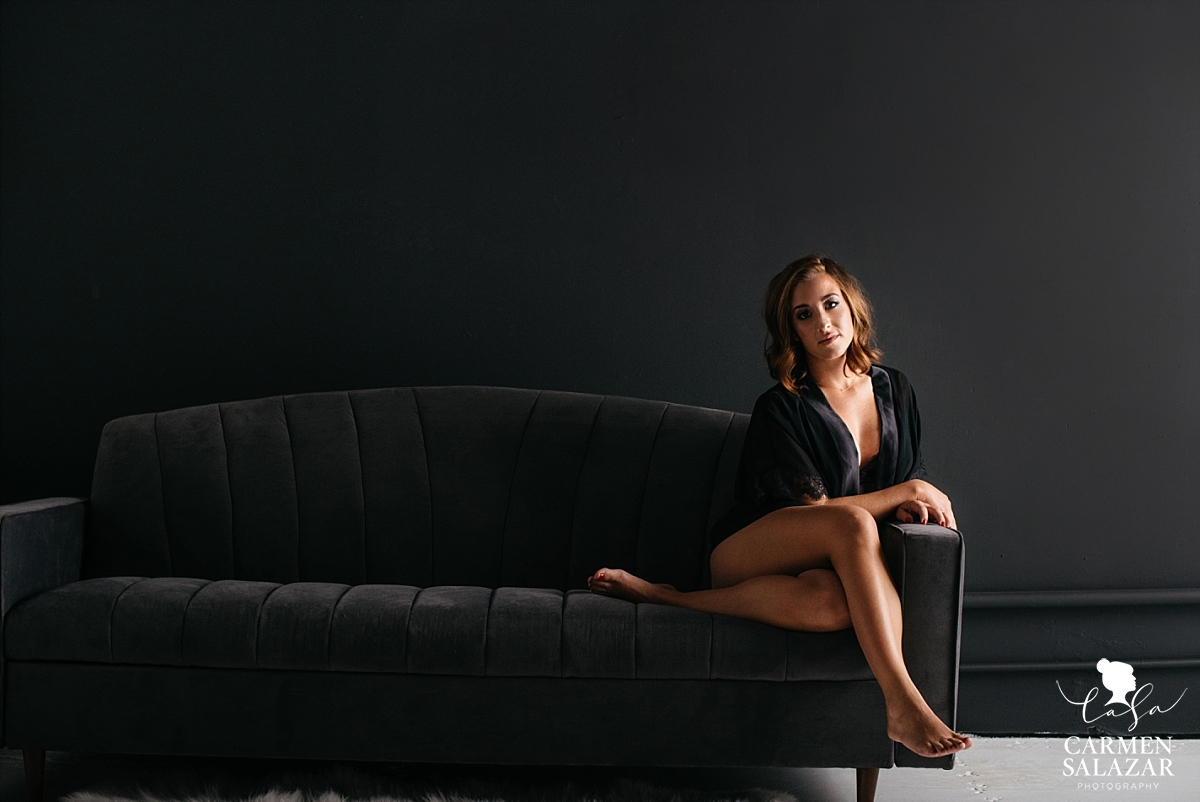 boudoir photo of woman in robe on couch by Carmen Salazar