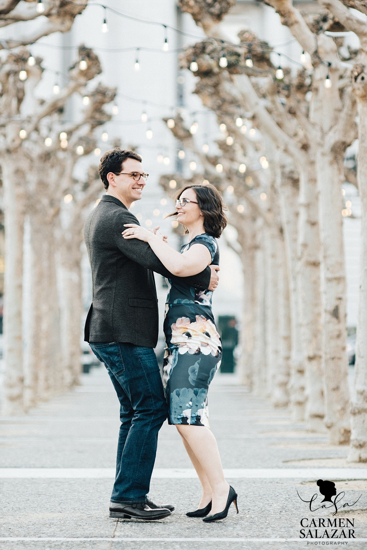 Engaged Couple dancing under lights at San Francisco City Hall