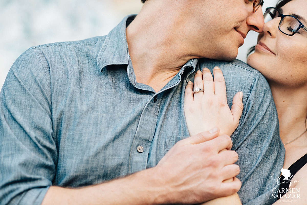 Intimate smiling couple with engagement ring by San Francisco wedding photographer Carmen Salazar