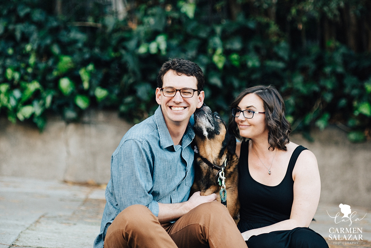 puppy kissing smiling couple in San Francisco engagement photos