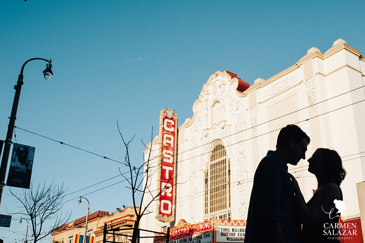 Silhouette of couple at Castro Theater by San Francisco wedding photographer Carmen Salazar