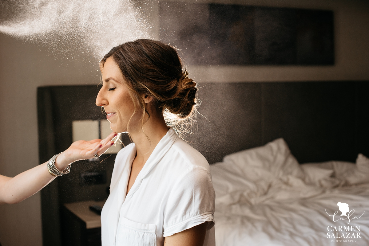 smiling bride getting ready with Christi Reynolds at Hilton Sacramento by Sacramento Wedding Photographer Carmen Salazar