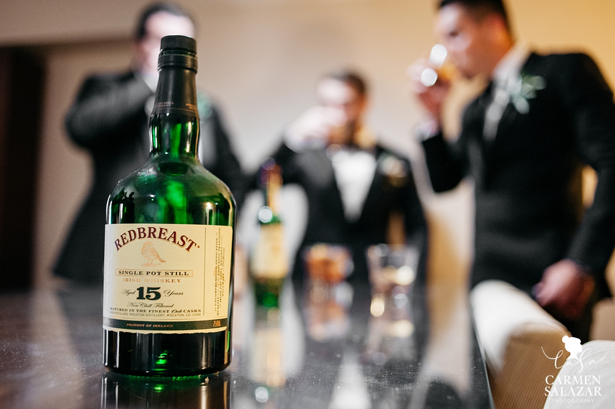 groomsmen wedding day whiskey shots at Hilton Sacramento by Sacramento wedding photographer Carmen Salazar