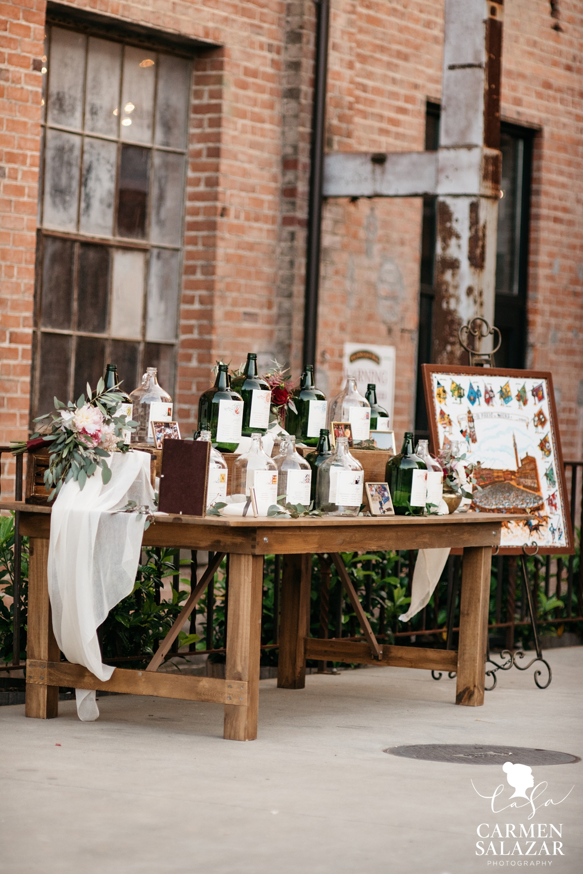 glass wine jug wedding seating chart at Old Sugar Mill by Sacramento Wedding Photographer Carmen Salazar