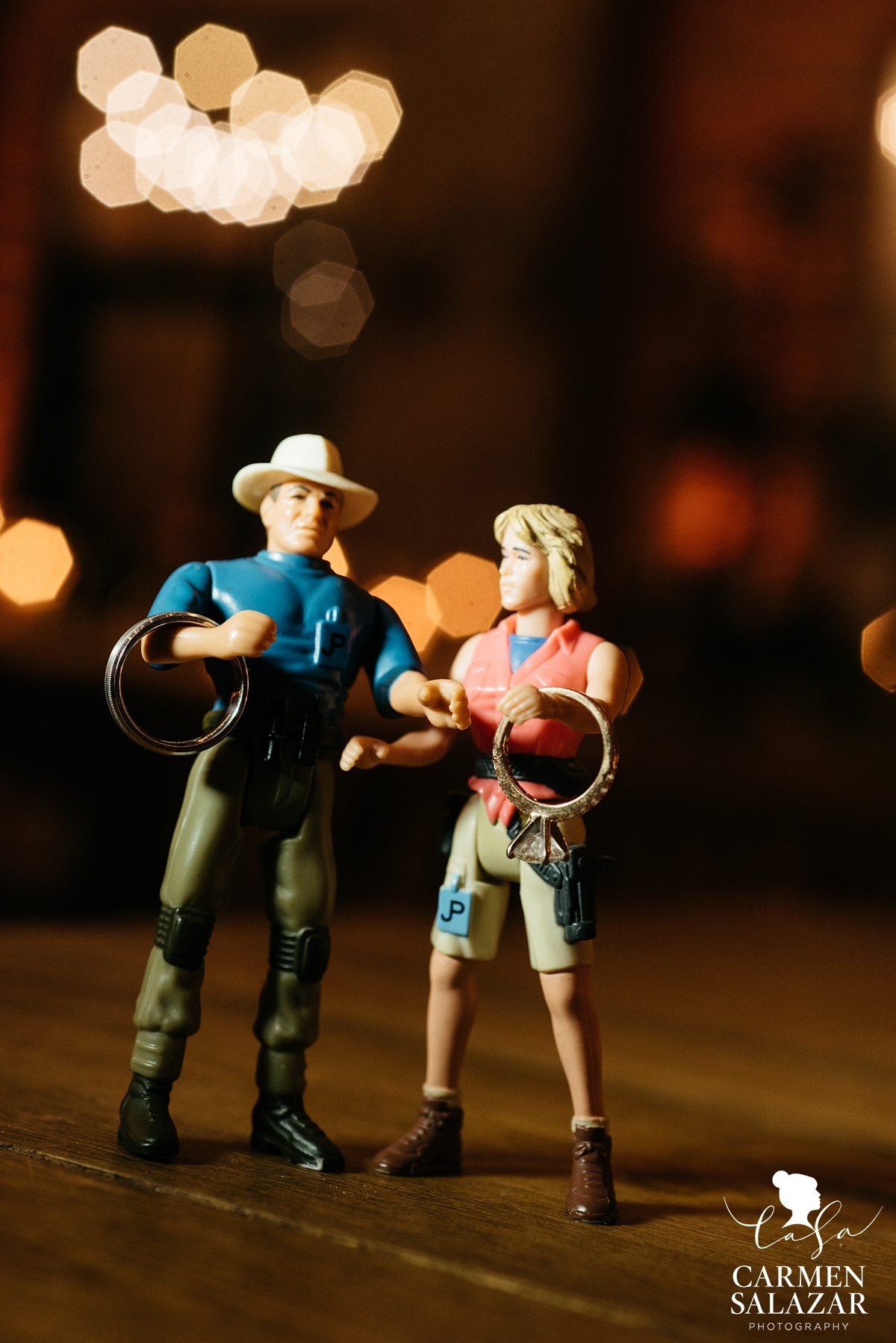 creative wedding ring photo with action figures by Sacramento Wedding Photographer Carmen Salazar