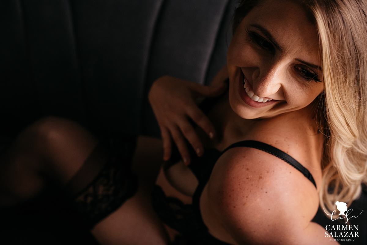 smiling intimate picture of woman by boudoir photographer Carmen Salazar
