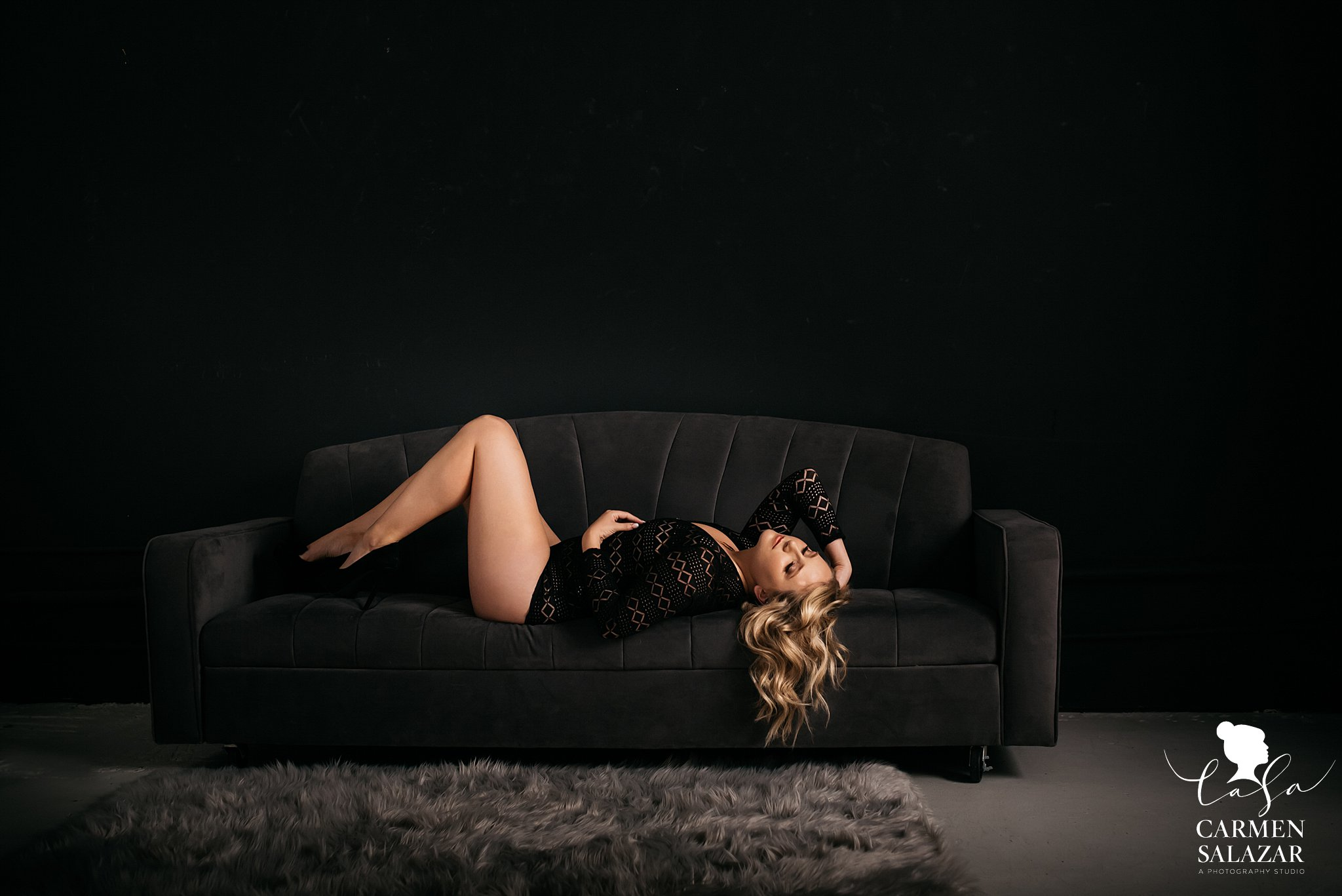 beautiful blonde woman in boudoir photo on couch