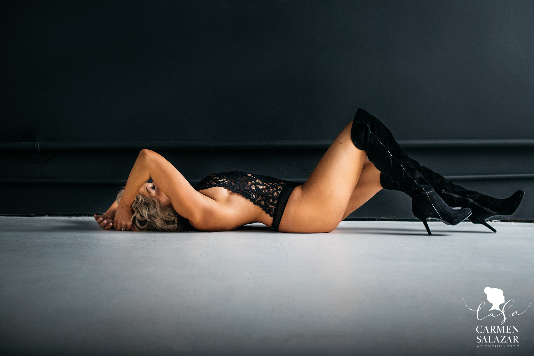 Boudoir picture of woman with high heels boots on the floor by Sacramento Boudoir photographer Carmen Salazar