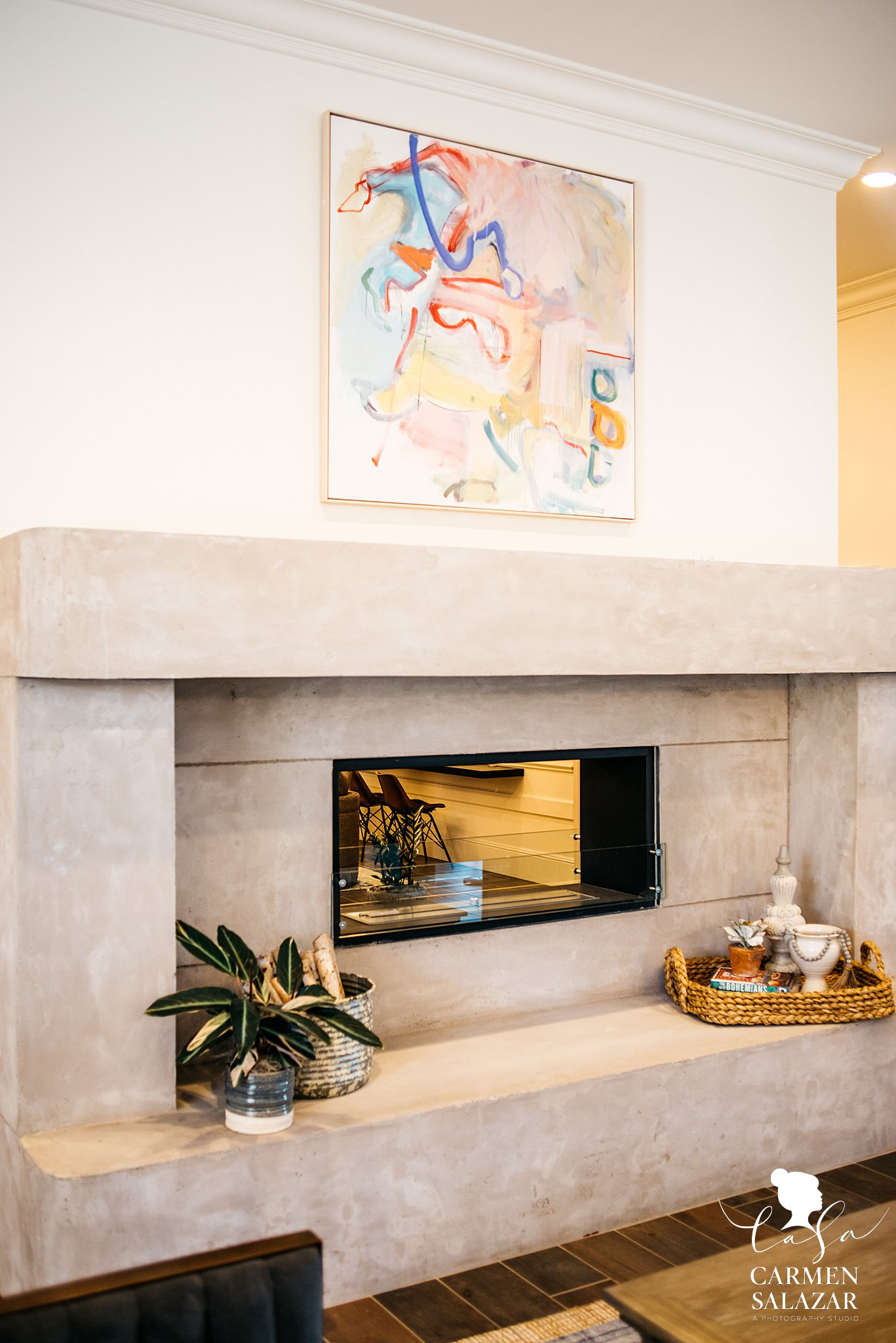 Modern fireplace with expressionist art above mental
