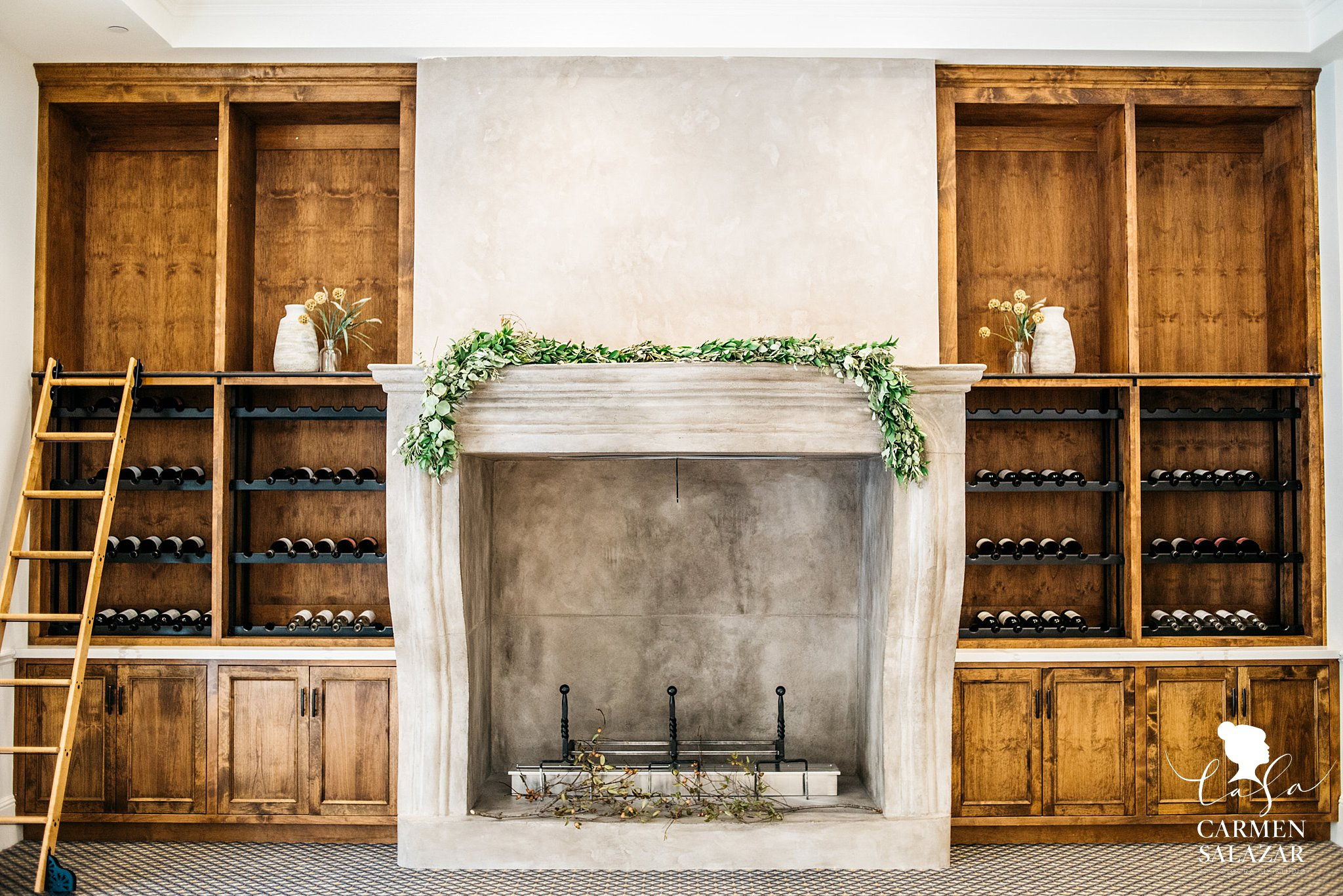 Rustic fireplace with wine cellar in wedding venue